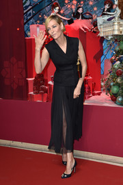 Uma Thurman kept it understated in a black double-breasted waistcoat by Dolce & Gabbana at the Printemps Christmas decorations inauguration.
