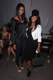 June Ambrose matched her high-contrast ensemble with a gray shoulder bag at Leila Shams' fashion show.