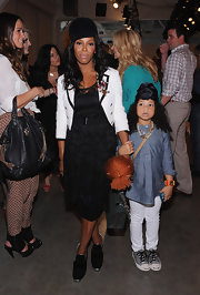 June Ambrose was seen at the Leila Shams fashion show wearing a lace dress, blazer, and a pair of suede ankle boots.
