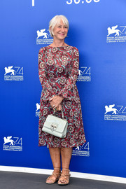 Helen Mirren sported a long-sleeve midi dress with a bold floral print at the Venice Film Festival photocall for 'The Leisure Seeker.'