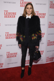 Olivia Palermo kept warm in edgy style with this fur jacket and leather skinnies combo at the New York screening of 'The Leisure Seeker.'