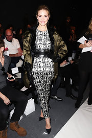Jaime King mixed the patterns of both her top and pants while attending the Lela Rose Fall 2012 runway show.