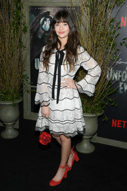 Malina Weissman finished off her sweet look with a beaded flower purse.