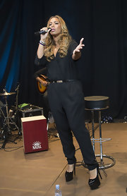 Leona Lewis sported a funky, '70s-inspired black jumpsuit while performing in London.