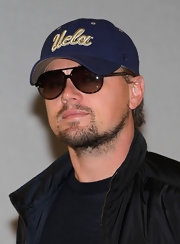 Leonardo arrived at the Japanese airport wearing dark aviator shades and a classic baseball cap.