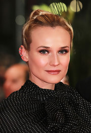 Diane Kruger wore her hair in a sleek classic bun at the premiere of 'Les Adieux De La Reine' in Germany.