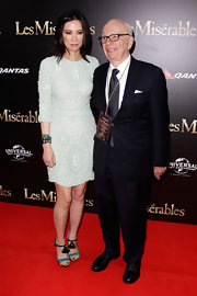 Wendi Deng posed at the 'Les Miserables' premiere wearing a curve-hugging white beaded dress.