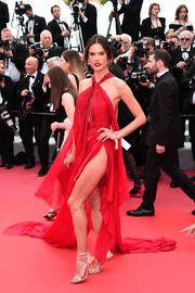 Alessandra Ambrosio teamed her frock with strappy gold heels by Giuseppe Zanotti.