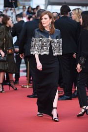 Julianne Moore punched up her look with a beaded leather cape, also by Louis Vuitton.