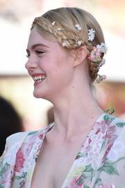 Elle Fanning looked romantic wearing this crown braid, complete with flower accents, at the 2019 Cannes Film Festival screening of 'Les Miserables.'