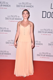 Florence Pugh paired her top with a matching pleated maxi skirt.