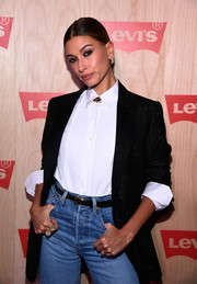 Hailey Baldwin accessorized with a pair of oversized gold rings at the Levi's Times Square store opening.