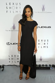 Zoe kept her look classic and sophisticated with a cap sleeve black dress that featured a high-low hem.