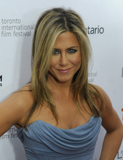 Jennifer Aniston complemented her glam dress with a trendy layered 'do when she attended the 'Life of Crime' premiere.