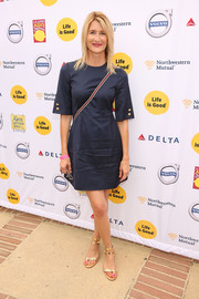 Laura Dern kept it relaxed in a navy mini dress during the LA Loves Alex's Lemonade event.