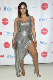 Ashley Graham kept the shine going with a pair of silver ankle-strap sandals.