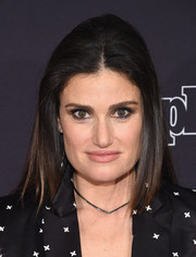 Idina Menzel wore her hair with a center part and a teased crown for a '60s vibe during the New York screening of 'Beaches.'