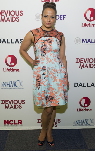 Judy Reyes sported a fun and flirty turquoise and peach-colored floral-print frock to the Dallas screening of 'Devious Maids.'