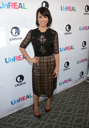 Constance Zimmer looked sweet at the 'UnREAL' Emmy FYC screening in a black lattice-and-flower-embroidered dress with a nude underlay.