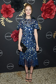 Caitlin Fitzgerald paired her lovely dress with black ankle-strap sandals.