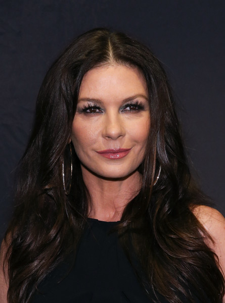 Catherine Zeta-Jones attended the Lifetime Luminaries screening of 'Cocaine Godmother' wearing a center-parted hairstyle with feathery ends.