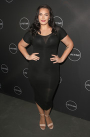 Arissa LeBrock sheathed her curvy figure in a form-fitting LBD for the 'Growing Up Supermodel' viewing party.