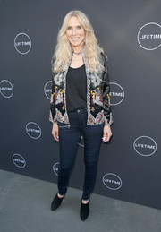 Alana Stewart chose a pair of black suede booties to finish off her look.
