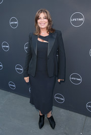 Kelly LeBrock teamed a tux jacket with a little black cutout dress for the 'Growing Up Supermodel' viewing party.