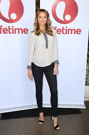 Stacy Keibler stuck to basic black and white when she wore this classic, patterned blouse.