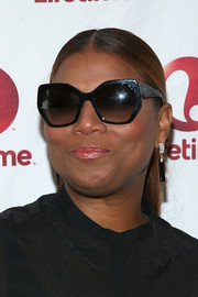 Queen Latifah hit the 'Real MVP: The Wanda Durant Story' premiere looking cool in her angular shades.