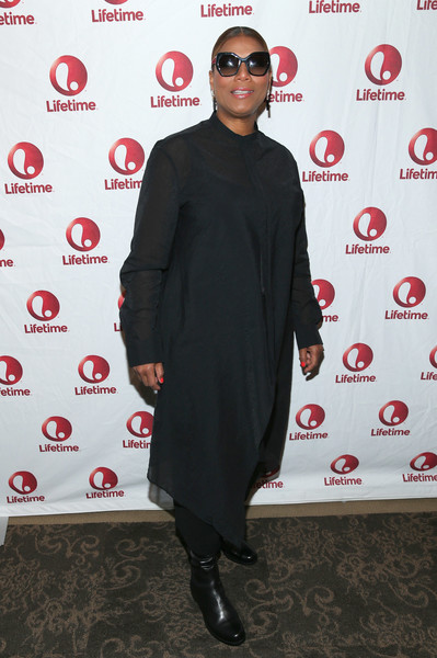 Queen Latifah paired flat boots with a black tunic for the 'Real MVP: The Wanda Durant Story' premiere.