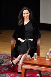 Angelina Jolie looked simply regal in a little black dress with an asymmetrical neckline at the 'Light After Darkness: Memory, Resilience and Renewal in Cambodia' discussion.