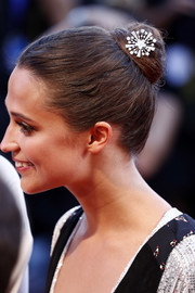 Alicia Vikander embellished her updo with an elegant silver hair pin.