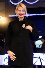 Simona Ventura looked retro-chic in her black evening coat.