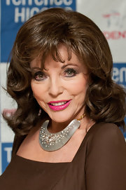 Joan Collins wore a statement collar necklace to the Lighthouse Gala Auction.