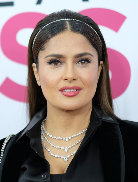 Salma Hayek added major glamour with a layered diamond necklace.