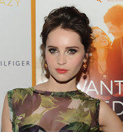 Felicity Jones wore a pair of 18-carat yellow gold and ruby earrings at the NYC premiere of 'Like Crazy.'