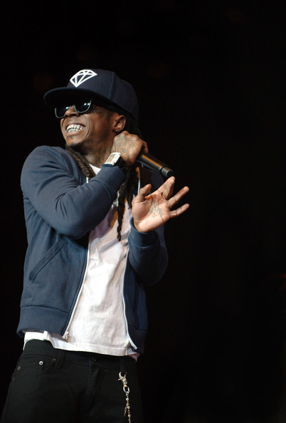 Lil Wayne wears a black his flat billed Diamond Supply logo hat for his performance at The Cajundome in Lafayette.