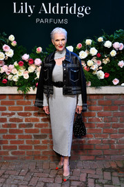 Maye Musk finished off her frock with a studded leather jacket by Nour Hammour.