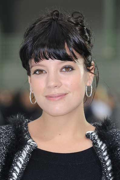 Lily Allen Pinned Up Ringlets [chanel - photocall,hair,face,hairstyle,eyebrow,chin,black hair,beauty,bangs,lip,fashion,lily allen,paris,france,grand palais,chanel ready to wear spring,paris fashion week,show]