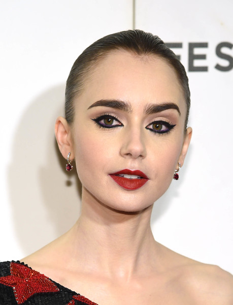Lily Collins Dangling Gemstone Earrings [hair,face,lip,eyebrow,hairstyle,skin,chin,beauty,head,cheek,lilly collins,shockingly evil and vile,new york city,bmcc tribeca pac,tribeca film festival]