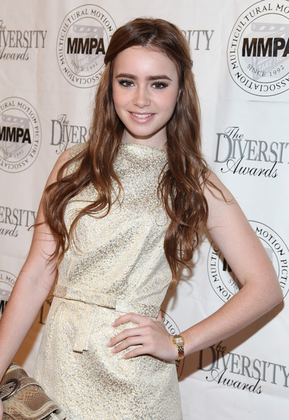 Lily Collins Gold Quartz Watch [hair,clothing,hairstyle,long hair,beauty,brown hair,eyelash,cocktail dress,dress,hair coloring,lily collins,oscar,luncheon,multicultural motion picture association student filmmaker oscar luncheon,montage beverly hills,california,multicultural motion picture association]