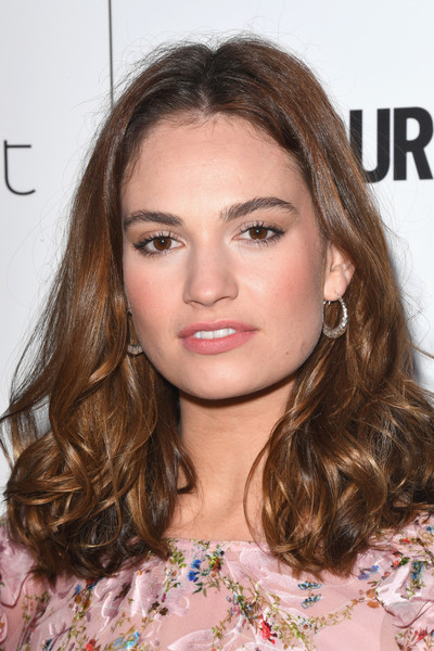 Lily James Medium Curls [hair,face,hairstyle,eyebrow,brown hair,blond,lip,chin,beauty,long hair,lily james,glamour women of the year awards,awards,england,london,berkeley square gardens,red carpet arrivals,glamour women of the year]