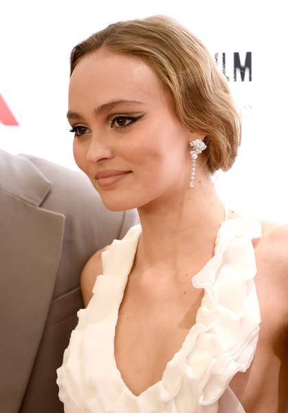 Lily-Rose Depp Dangling Diamond Earrings [the king,the king uk premiere,hair,face,hairstyle,skin,blond,chin,beauty,lip,eyebrow,lady,lily-rose depp,uk,odeon luxe leicester square,london,england,premiere,bfi london film festival]