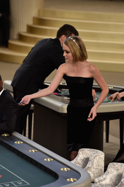 Lily-Rose Depp Strapless Dress [show,indoor games and sports,pool,girl,formal wear,dress,english billiards,fun,recreation,games,table,lily rose depp,front row,part,paris,france,chanel,haute couture fall,paris fashion week]