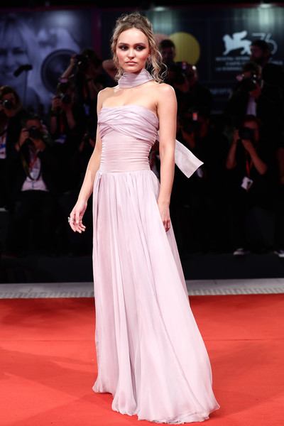 Lily-Rose Depp Strapless Dress [the king red carpet,the king,fashion model,dress,gown,clothing,red carpet,shoulder,carpet,fashion,flooring,premiere,lily-rose depp,sala grande,red carpet,venice,italy,76th venice film festival]