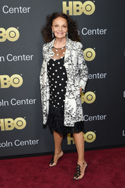 Diane von Furstenberg attended the American Songbook Gala wearing a black cocktail dress with white square accents and a ruffled hem.