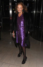 Diane von Furstenberg glittered in a purple sequined dress at the Ralph Lauren soiree in NYC. The famed designer topped off the look with black satin criss-cross sandals.