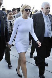 Lindsay arrives at the courthouse in a knit white dress for her felony charges.
