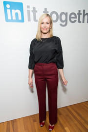 Chelsea Handler paired her top with high-waisted red trousers.
